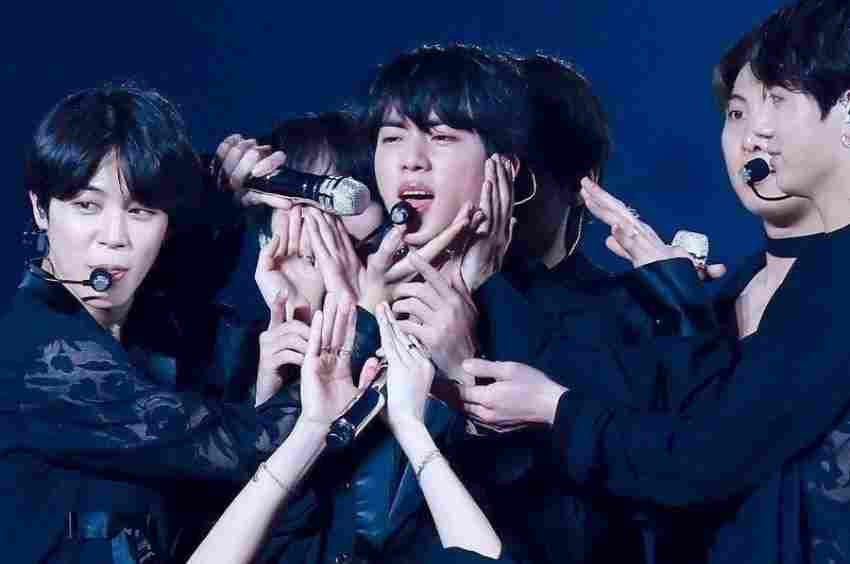 Check Out How Jin Takes Care of All BTS Members